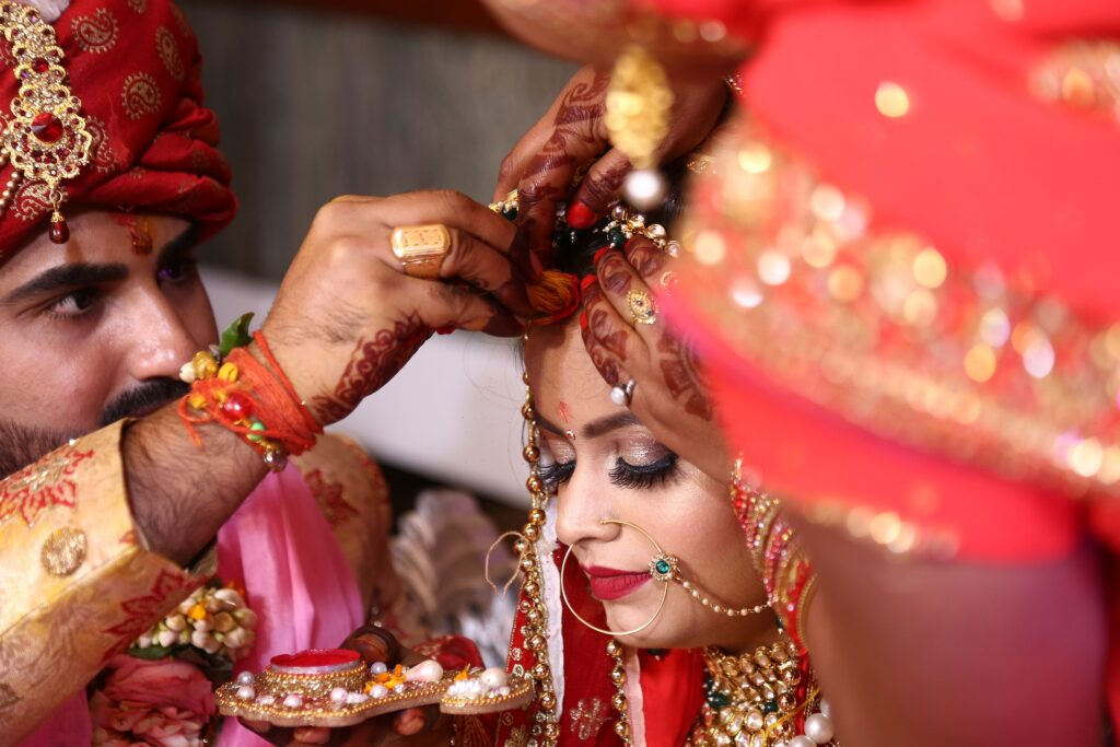 man putting sindoor marriages in india entertainments saga 1024x683 1
